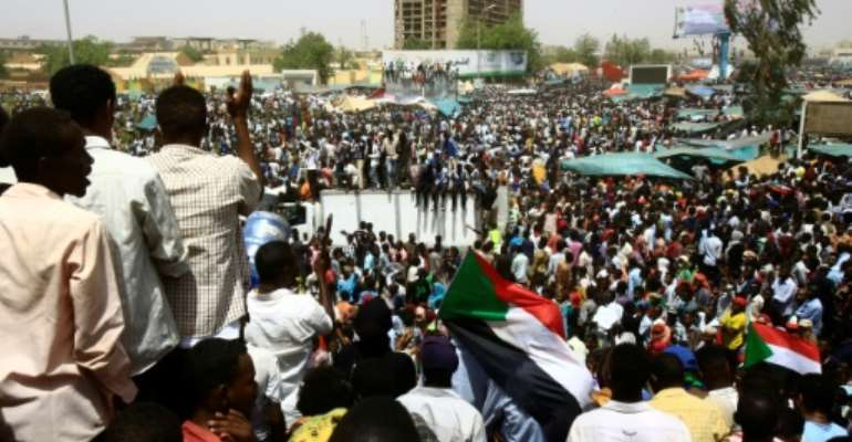 Sudanese demonstrators gather in Khartoum as the army says it has toppled Omar al-Bashir, one of Africa's longest-serving presidents.  By ASHRAF SHAZLY (AFP)