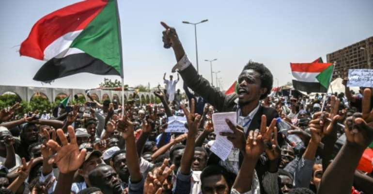 Sudanese demonstrators pushing for change have camped out in front of the the army headquarters in Khartoum for weeks, turning it into the latest icon of protest around the world.  By OZAN KOSE (AFP)
