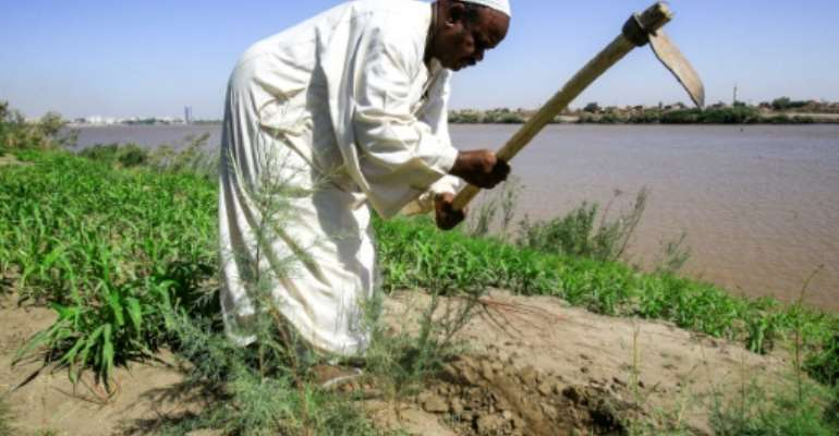 Sudanese farmers like Othman Idris say Ethiopia's construction of a controversial dam on the Blue Nile is a dream come true that would regulate flooding during rainy seasons.  By ASHRAF SHAZLY (AFP)
