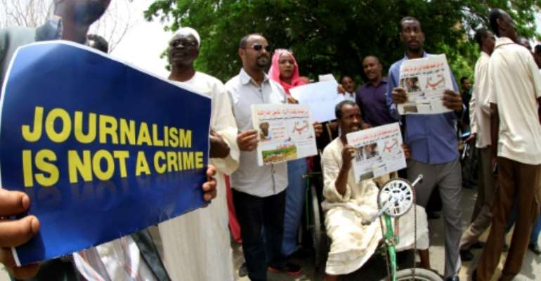 Sudanese journalists protest in Khartoum on July 20, 2014.  By ASHRAF SHAZLY (AFP/File)