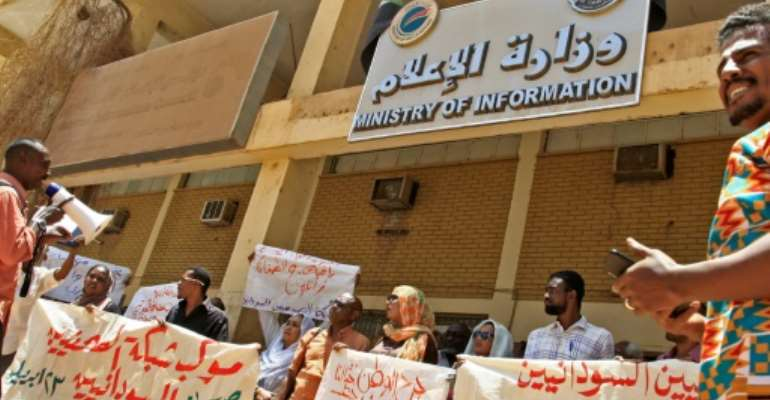 Sudanese journalists take part in a demonstration outside the information ministry.  By - (AFP)