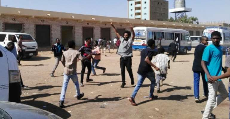 Sudanese protest in the streets of the capital Khartoum on January 13, 2019.  By STRINGER (AFP)
