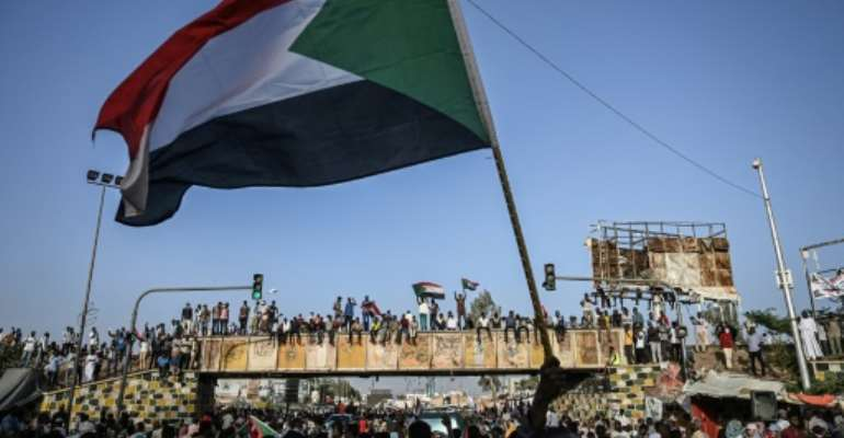 Sudanese protesters are looking to step up pressure on the army three weeks after the ouster of leader Omar al-Bashir.  By OZAN KOSE (AFP/File)