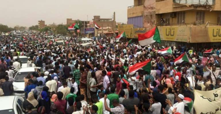 Sudanese protesters chant slogans demanding civilian rule during a rally in Khartoum's southern al-Sahafa district.  By - (AFP)