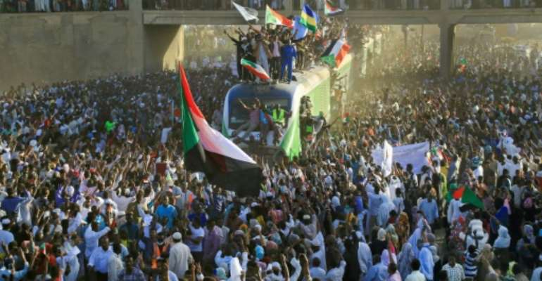 Sudanese protesters days ago celebrated the first anniversary of the uprising that toppled Omar al-Bashir and to demand justice for slain protesters.  By ASHRAF SHAZLY (AFP/File)