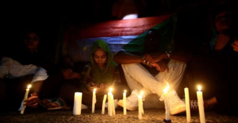 Sudanese protesters have held regular vigils to remember those killed in the June crackdown on a long-running sit-in outside army headquarters in Khartoum.  By ASHRAF SHAZLY (AFP/File)