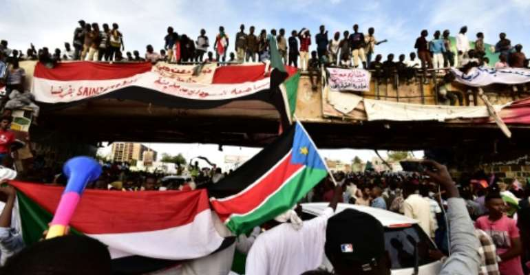 Sudanese protesters have kept up a sit-in outside army headquarters in Khartoum since April 6.  By Ahmed MUSTAFA (AFP)