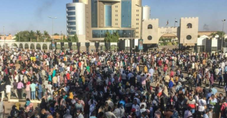 Sudanese protesters shout anti-government slogans outside the military headquarters in the capital Khartoum on April 6, 2019.  By - (AFP)