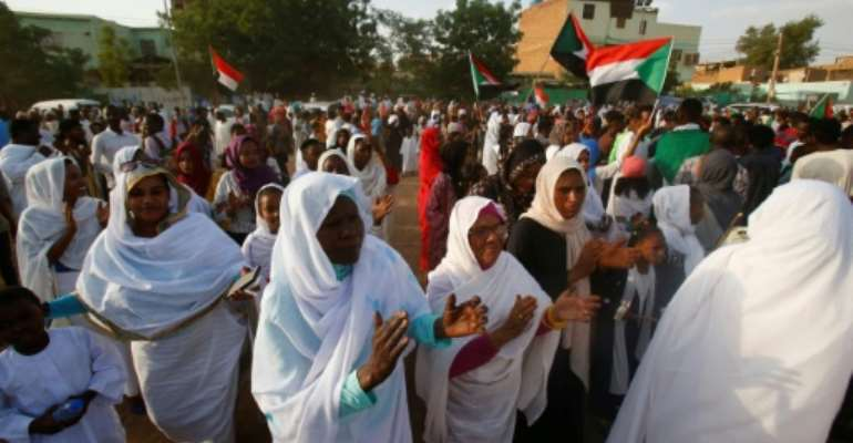 Sudanese women applauded on Saturday in celebration of a power sharing agreement between protest leaders and the ruling military council.  By ASHRAF SHAZLY (AFP)