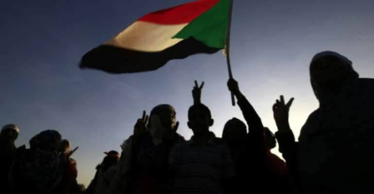 Sudanese women marched in Khartoum on Monday to mark International Day for the Elimination of  Violence against Women, a day ahead of the cabinet reportedly scrapping a restrictive public order law.  By Ashraf SHAZLY (AFP)