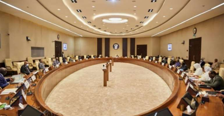 Sudan's cabinet vote to ratify the Rome Statute of the International Criminal Court on Tuesday, seen here in a picture provided by Sudan's Prime Minister's official Twitter account.  By - (Office of Sudan's Prime Minister/AFP)