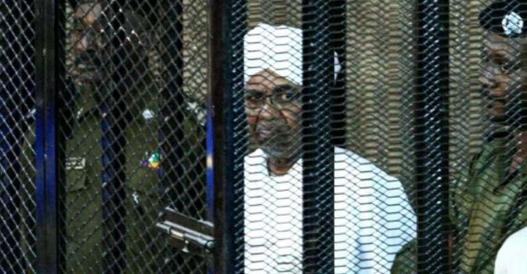 Sudan's ex-president Omar al-Bashir appears in court in Khartoum in August 2019.  By Ebrahim HAMID (AFP/File)