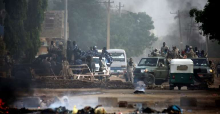 Sudan's military forcefully broke up a weeks-long sit-in outside Khartoum's army headquarters.  By ASHRAF SHAZLY (AFP)