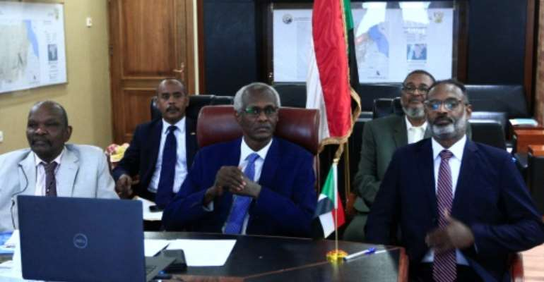Sudan's Minister of Irrigation and Water Yasser Abbas participates in a videoconference with his Egyptian and Ethiopian counterparts over a giant Blue Nile dam.  By Ebrahim HAMID (AFP)