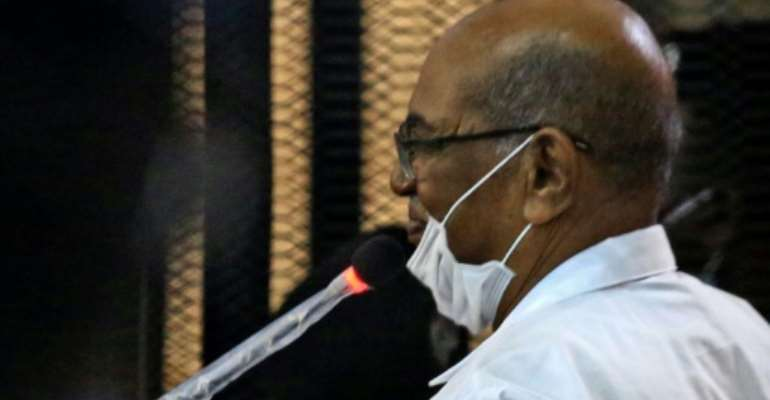 Sudan's ousted president Omar al-Bashir answers procedural questions during his trial in Khartoum.  By ASHRAF SHAZLY (AFP)
