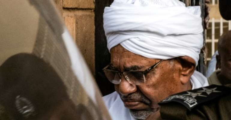 Sudan's ousted president Omar al-Bashir is accused of possessing foreign currency, corruption and receiving gifts illegally.  By Yasuyoshi CHIBA (AFP/File)