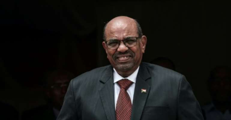 Sudan's President Omar al-Bashir has decided to sack the 31-member cabinet and form a new government to tackle the country's growing economic crisis..  By Yasuyoshi CHIBA (AFP)