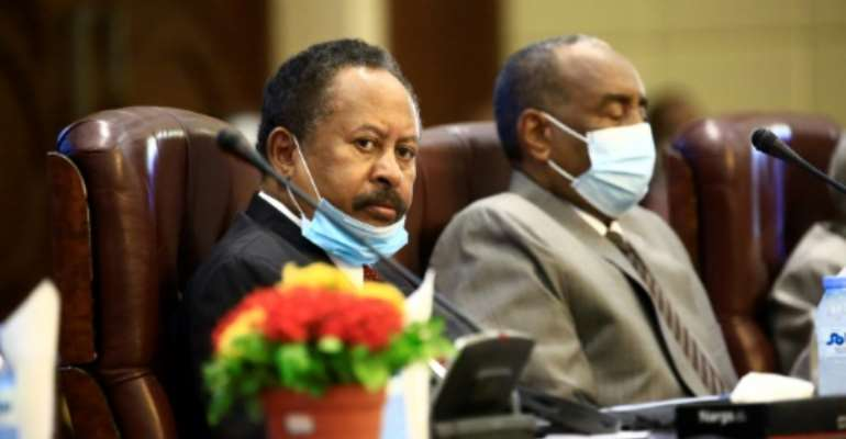 Sudan's Prime Minister Abdalla Hamdok has hailed US plans to remove the northeast African country from its state sponsors of terrorism blacklist.  By ASHRAF SHAZLY (AFP/File)