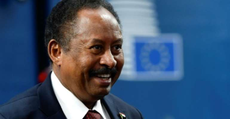 Sudan's Prime Minister Abdalla Hamdok, seen here in November 2019, is making a rare visit to Washington.  By JOHN THYS (AFP/File)