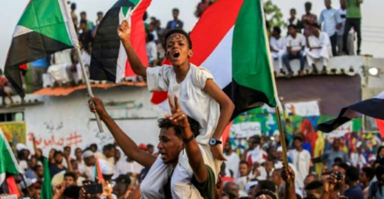 Sudan's ruling military council and protest leaders reached a power-sharing deal in the early hours of Friday.  By ASHRAF SHAZLY (AFP)