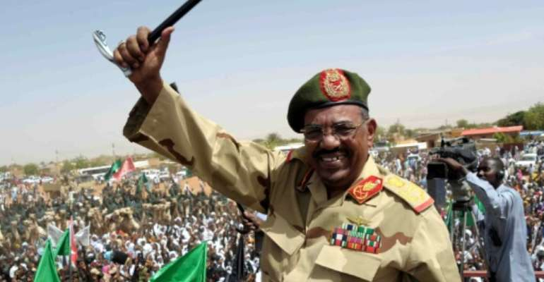 Sudan's toppled president Omar al-Bashir waves to the crowd during an April 2012 visit to the Northern Kordofan town of El-Obeid to address newly-trained paramilitary troops.  By EBRAHIM HAMID (AFP/File)