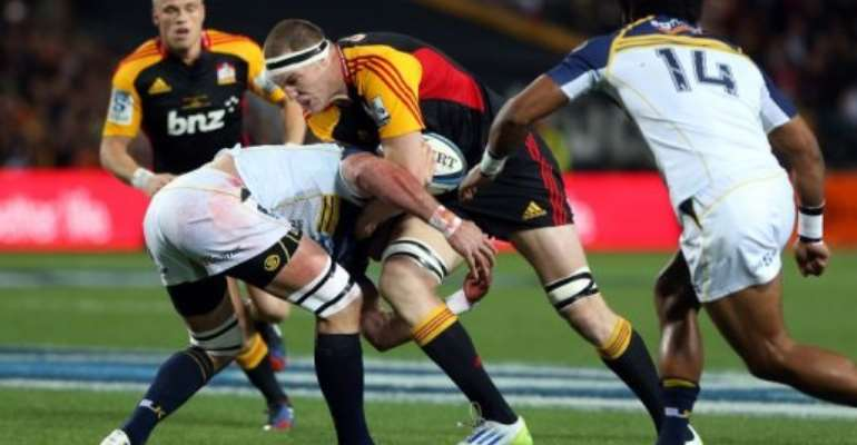 Chiefs Brodie Retallick is tackled by Brumbies Ben Mowen during their Super 15 rugby match on August 03, 2013..  By Michael Bradley (AFP File)