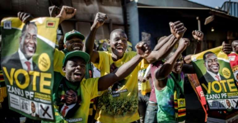 Supporters celebrated after Zimbabwe's President Emmerson Mnangagwa was declared the winner in the country's landmark election.  By Luis TATO (AFP)
