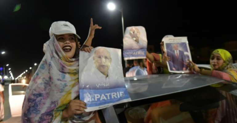 Supporters celebrated Mohamed Ould Ghazouani's victory in Mauritania's presidential election which is set to be the first democratic transfer of power in the country.  By Sia KAMBOU (AFP)