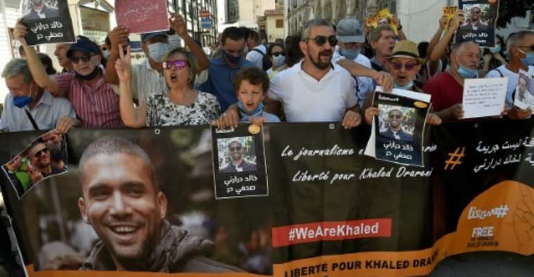 Supporters of Algerian journalist Khaled Drareni, who was sentenced to two years in prison, had been hoping for a lenient judgement, if not acquittal.  By RYAD KRAMDI (AFP)