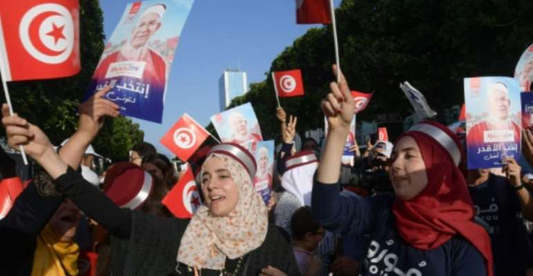 Supporters of Ennahdha candidate Abdelfattah Mourou attend an event on Thursday, as campaigning came to a close in Tunisia's presidential poll.  By FETHI BELAID (AFP/File)