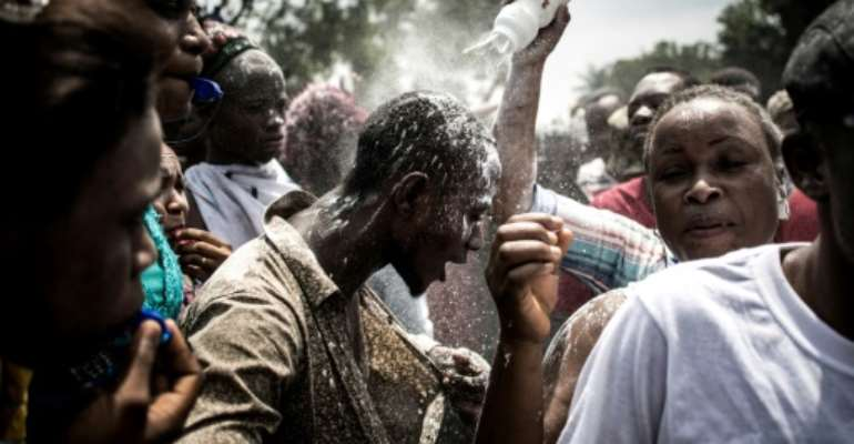 Supporters of Felix Tshisekedi, who was declared winner of Democratic Republic of Congo's election, celebrate but opposition candidate Martin Fayulu has denounced the result as fraud.  By John WESSELS (AFP/File)