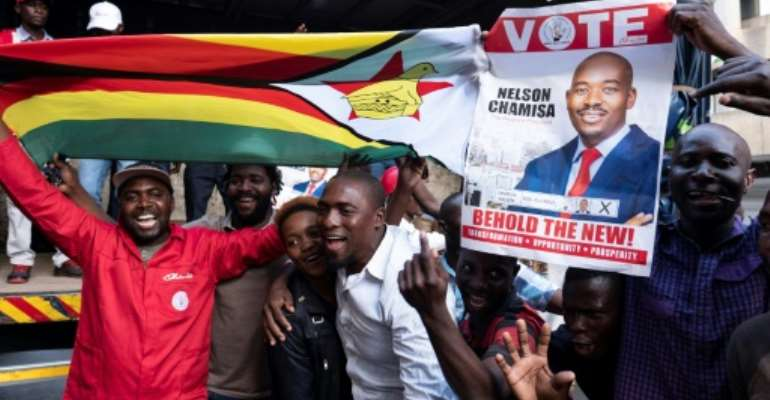 Supporters of opposition presidential candidate Nelson Chamisa were buoyant Tuesday but authorities warned vote counting would likely take several more days to complete.  By MARCO LONGARI (AFP)