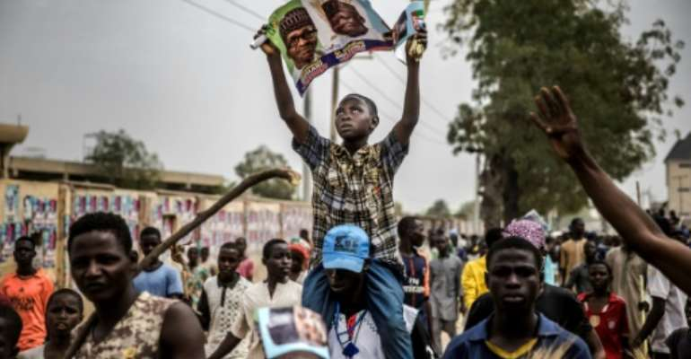 Supporters of President Muhammadu Buhari celebrated his election victory last month, but the violence that marred some polls that have had to be re-run appeared to have returned Saturday.  By Luis TATO (AFP)