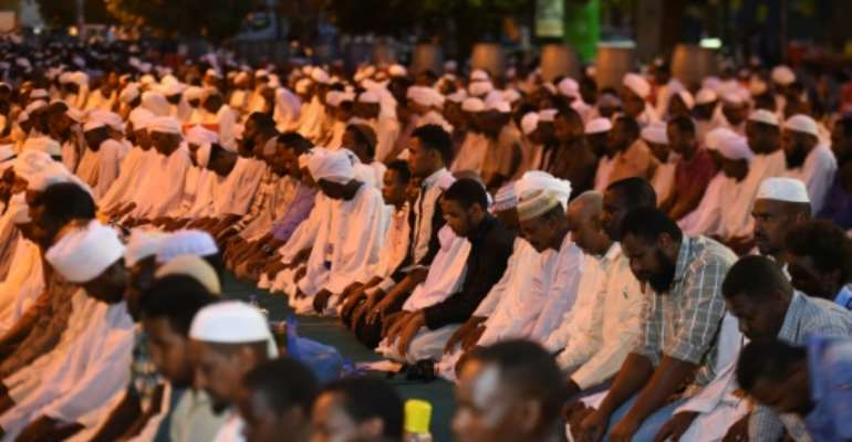 Supporters of Sudanese Islamist movements pray in the capital Khartoum on Saturday, as they launch organised demonstrations for the first time to counter the influence of the country's main protest movement.  By MOHAMED EL-SHAHED (AFP)