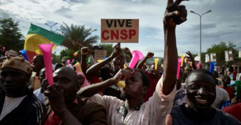 Supporters of the military junta, which calls itself the National Committee for the Salvation of the People, or CNSP, take part in a rally in Bamako this week.  By MICHELE CATTANI (AFP/File)