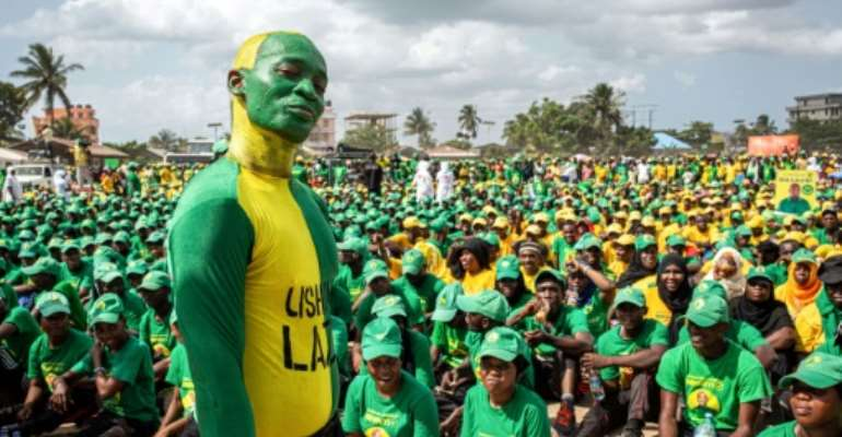 Supporters of the Tanzanian ruling party Chama Cha Mapinduzi gather at the Kibanda Maiti Stadium during the last campaign rally.  By Patrick Meinhardt (AFP/File)