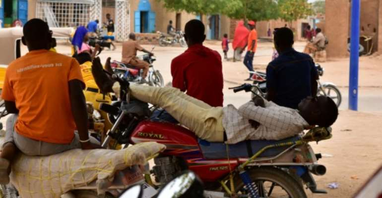 Taxi drivers, like others in Agadez, a transport hub in central Niger, have felt the pinch following a government crackdown on transporting migrants.  By ISSOUF SANOGO (AFP)