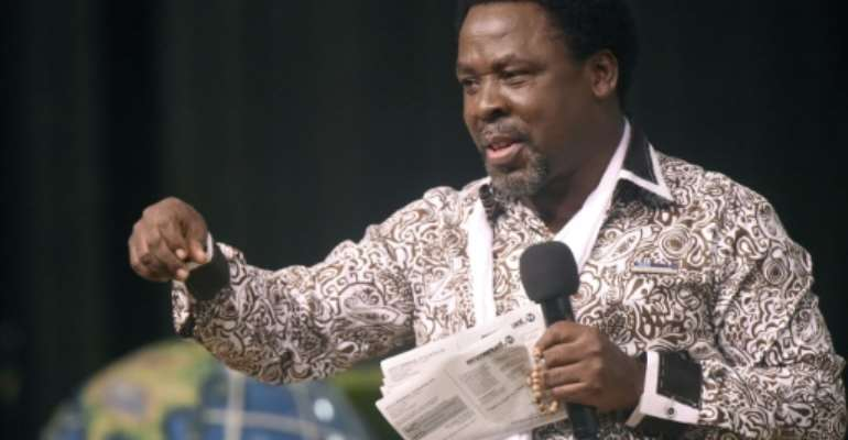 TB Joshua is one of several so-called faith healers in Nigeria claiming an ability to cure people of AIDS.  By PIUS UTOMI EKPEI (AFP/File)