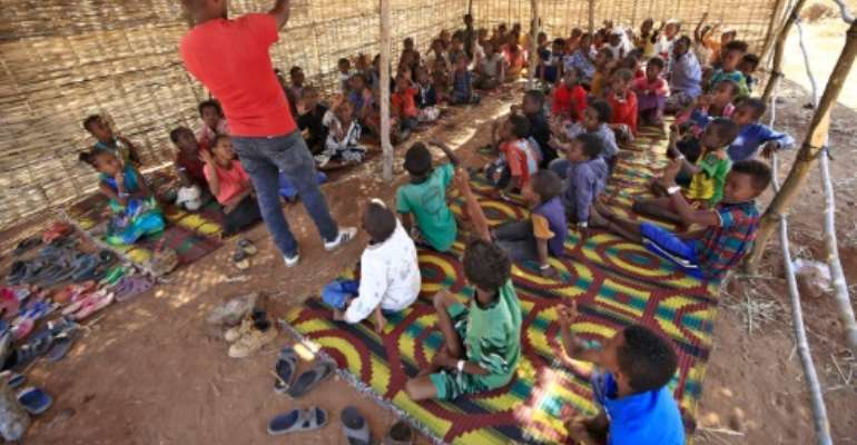 Teachers among the tens of thousands of Ethiopians who have streamed into neighbouring Sudan in recent weeks have set up schools for refugee children with help from the Norwegian Refugee Council.  By ASHRAF SHAZLY (AFP)