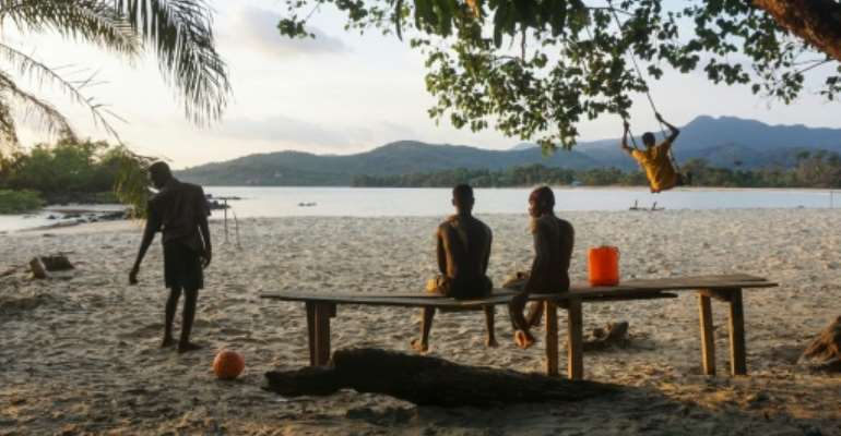 Teenagers on the Black Johnson beach. A tourist attraction 22 miles south of the capital Freetown, Black Johnson village is nestled between stunning black-and-gold beaches and virgin rainforest.  By Saidu BAH (AFP)