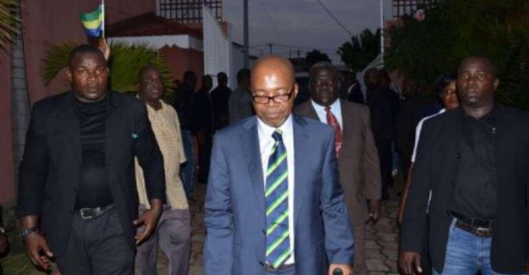 Gabon's main opposition leader Andre Mba Obame (C) arrives at his home in Libreville.  By Patrick Fort (AFP/File)
