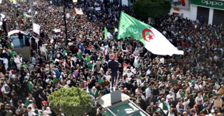 Tens of thousands of Algerians have protested against President Abdelaziz Bouteflika in recent weeks.  By RYAD KRAMDI (AFP/File)