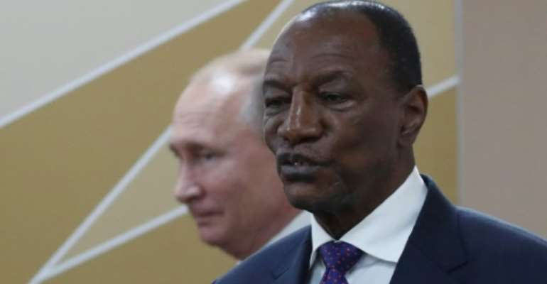 Tens of thousands of people have rallied in favor of Guinea's President Alpha Conde, pictured with Russian President Vladimir Putin October 24, 2019.  By Sergei CHIRIKOV (POOL/AFP)