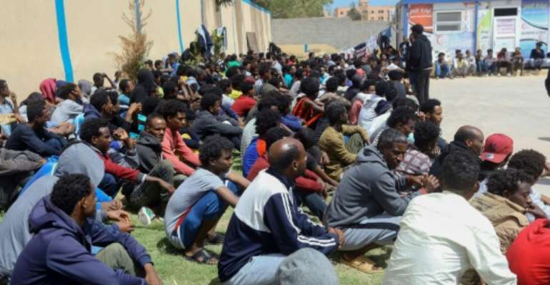 Tens of thousands of refugees and asylum-seekers -- similar to these African migrants who fled Libyan battle zones, pictured April 2019 at at a detention center in Zawiya -- have been stranded in chaos-wracked Libya.  By Mahmud TURKIA (AFP/File)