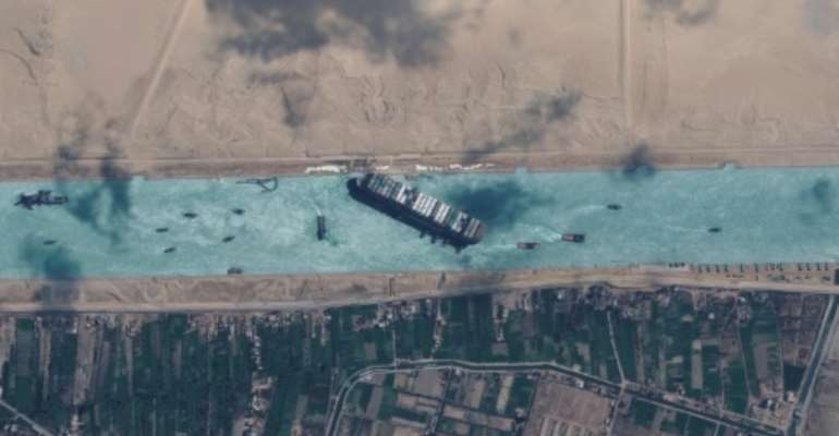 The 200,000-tonne MV Ever Given (shown in satellite imagery released by Maxar Technologies) got diagonally stuck in the Suez Canal in a sandstorm on March 23, 2021, triggering a mammoth six-day-long effort to dislodge it.  By - (Satellite image ©2021 Maxar Technologies/AFP/File)