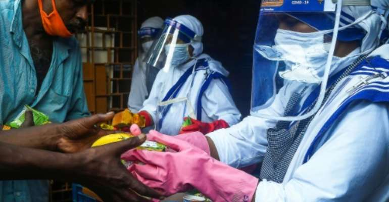 The 86,432 new cases took India to 4,023,179 infections, third behind the United States and just trailing Brazil.  By Dibyangshu SARKAR (AFP)