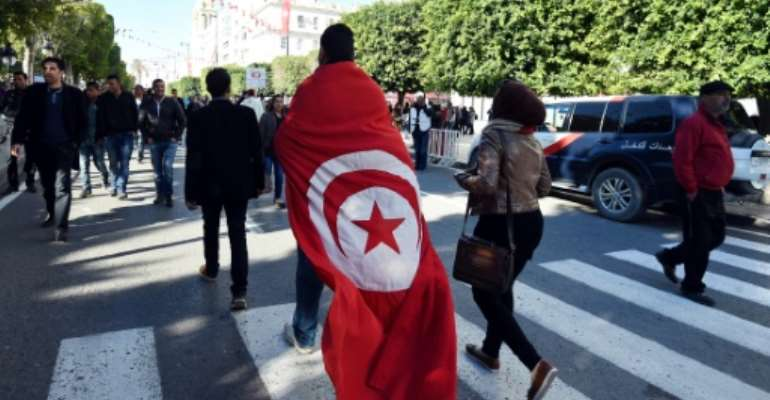 The anniversary of Tunisia's 2011 revolution is marked with rallies.  By FETHI BELAID (AFP/File)
