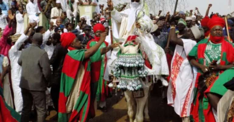 The annual procession sees the traditional mayor of Kano, Muhammadu Sanusi, go through the town on horseback and pay tribute to the governor.  By AMINU ABUBAKAR (AFP/File)