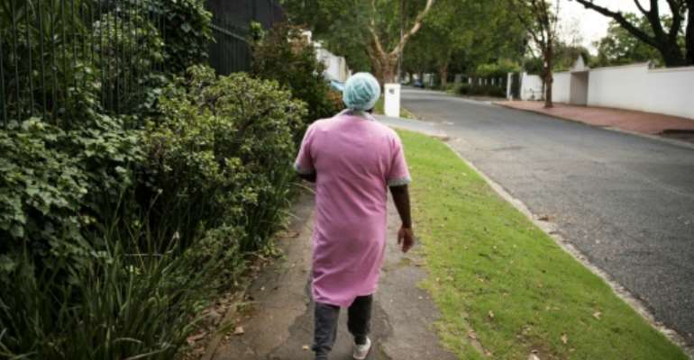 The apartheid era legacy of domestic staff 'living in'  makes it easier for employers to ignore labour laws, say advocacy groups in South Africa.  By Guillem Sartorio (AFP)