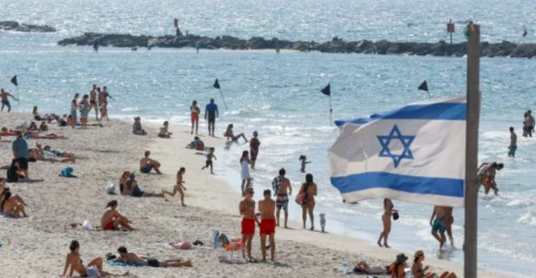 The beach in the Israeli coastal city of Tel Aviv reopened on Sunday as new infection numbers receded.  By JACK GUEZ (AFP)